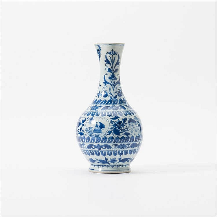 A bulbous blue and white jug with long neck