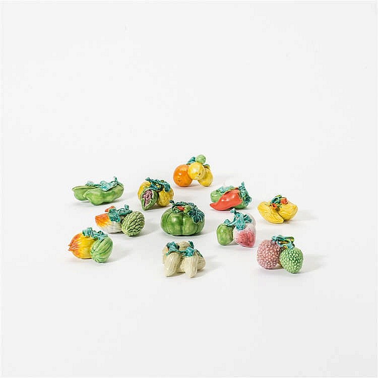 Eleven various groups of miniature fruits