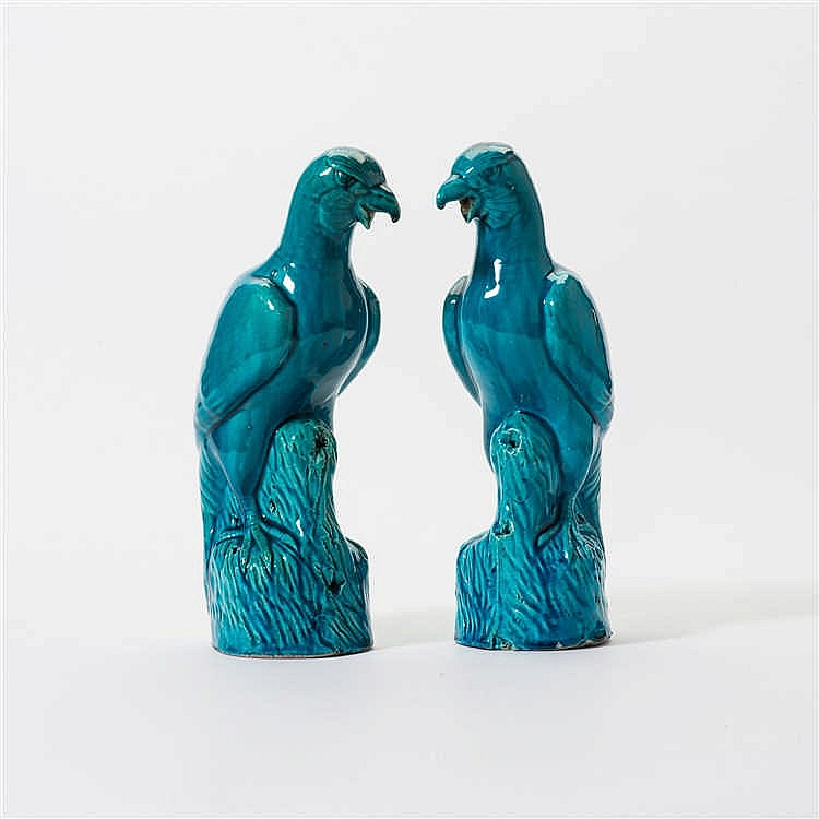 A pair of turquoise glazed parrots