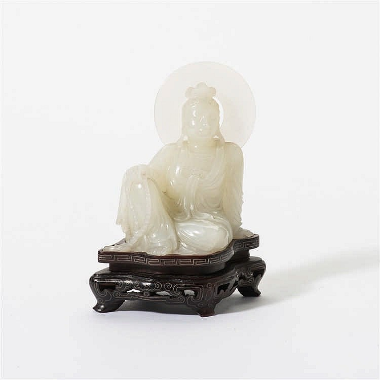 A white jade seated Guanyin with nimbus