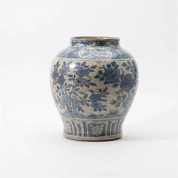A large baluster-shaped blue and white vase with wide neck