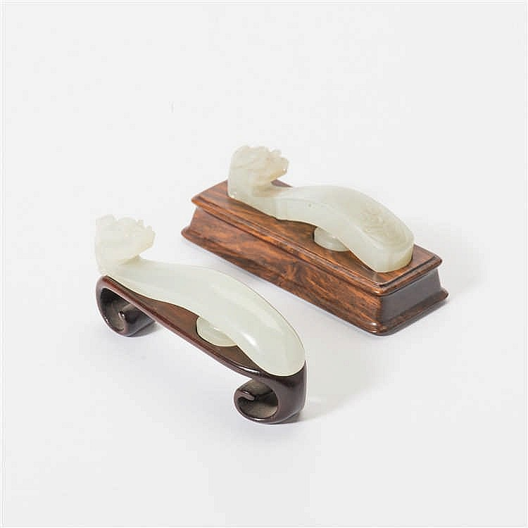 Two celadon jade belt hooks