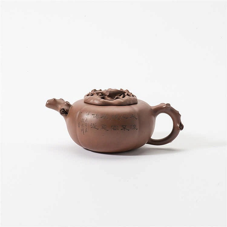 A lobed Yixing teapot with lid