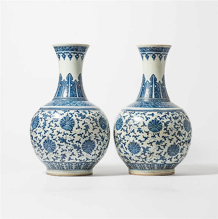 A pair of large bulbous blue and white vases