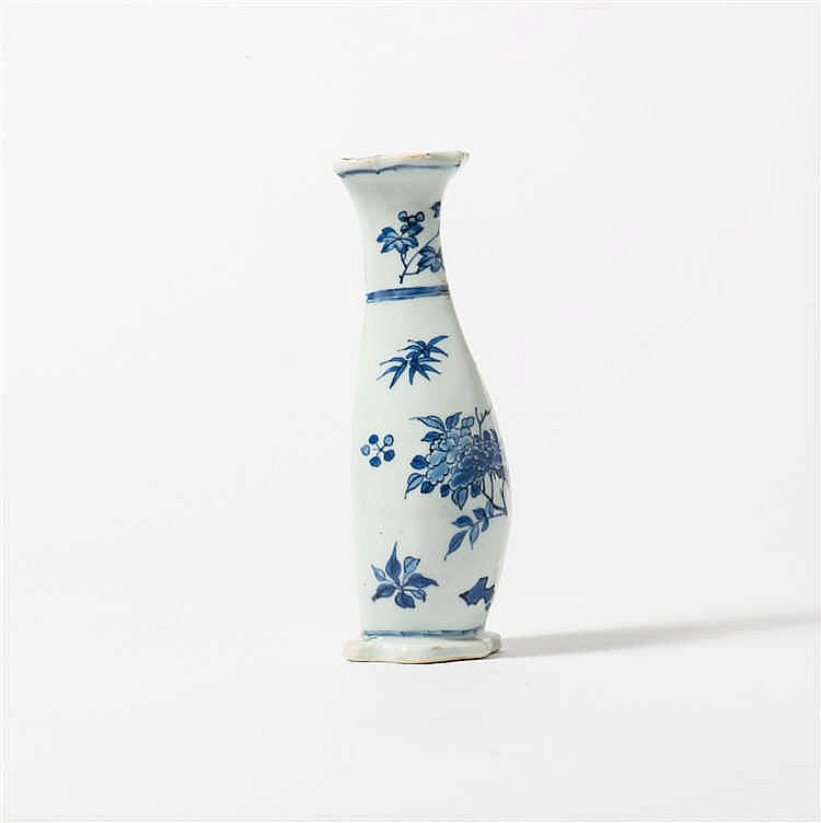 A pear-shaped blue and white wall vase