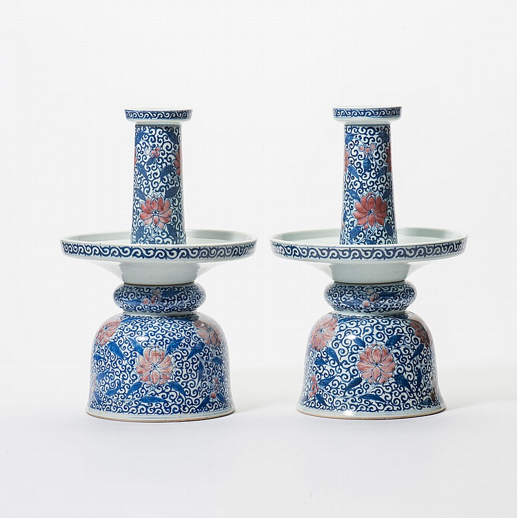 A pair of two-part candlesticks