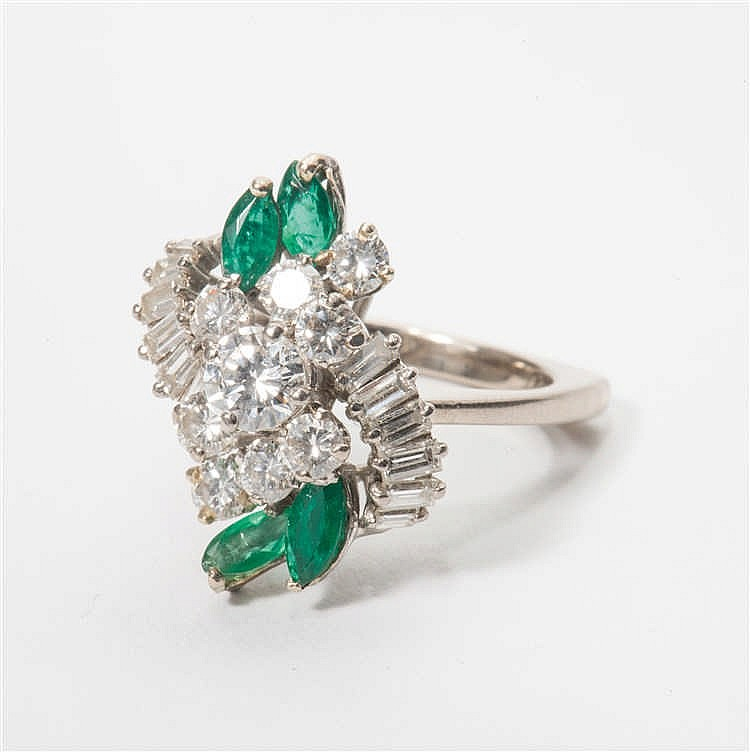 an 18 carat white gold ring with diamonds and emeralds