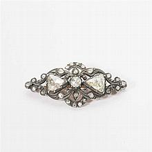 A 14 carat gold and silver brooch with diamonds