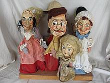 Seven vintage Papier Mache hand puppets on stand