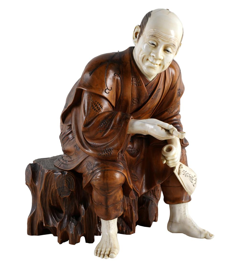 JAPANESE CARVED BOXWOOD FIGURE OF A SEATED MAN