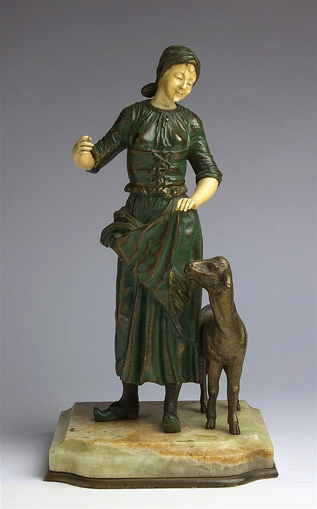 A gilt bronze and ivory figural group depicting a shepherdess with a sheep - France, late 19th / early 20th Century (pre-1947)