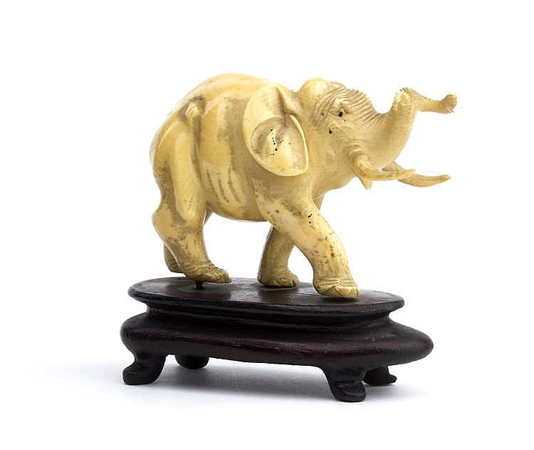 A carved i vory sculpture depicting an elephant - China, early 20th Century (pre-1947)