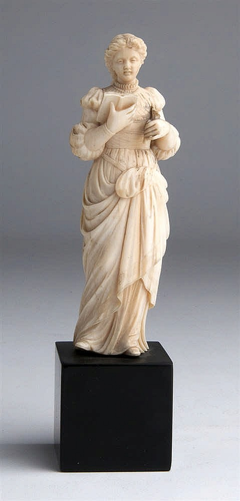 A carved ivory figure of a lady - England, 19th Century