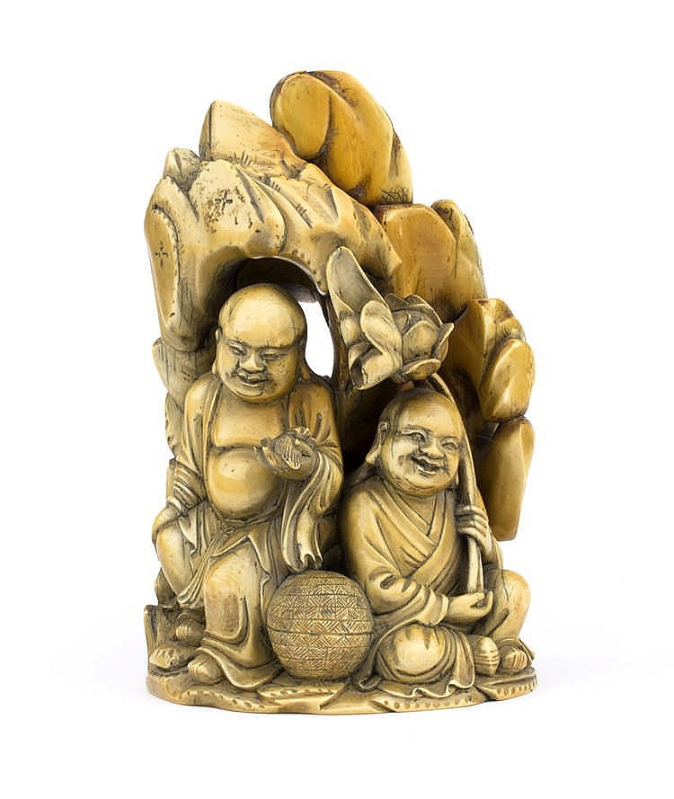 A carved ivory sculpture depicting two Buddhist Monks - China, 19th Century