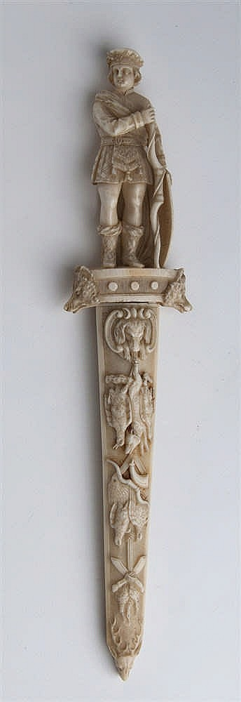 A carved ivory paper knife, the handle depicting a hunter - Germany, late 19th / early 20th Century (pre-1947)