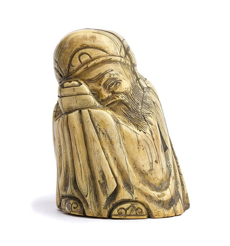 A carved ivory sculpture depicting a Chinese God - China, 19th Century