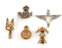 ECLECTIC GROUPING OF 5 BRITISH MILITARY BADGES SAS