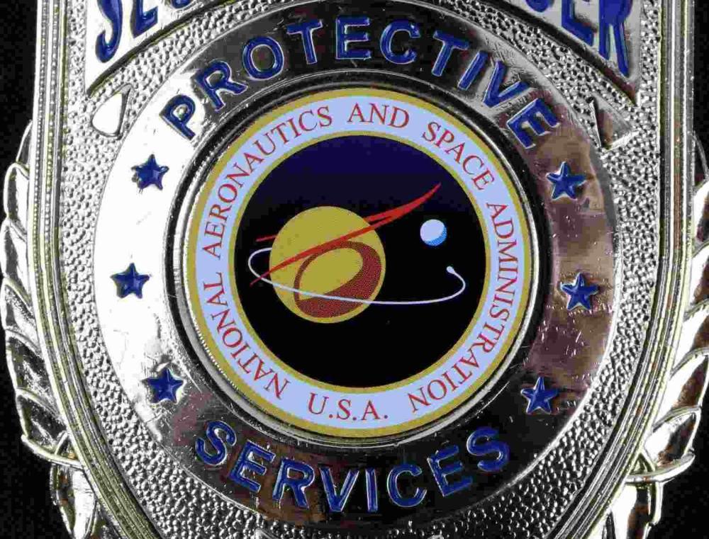 VINTAGE NASA SECURITY OFFICER SPACE BADGE
