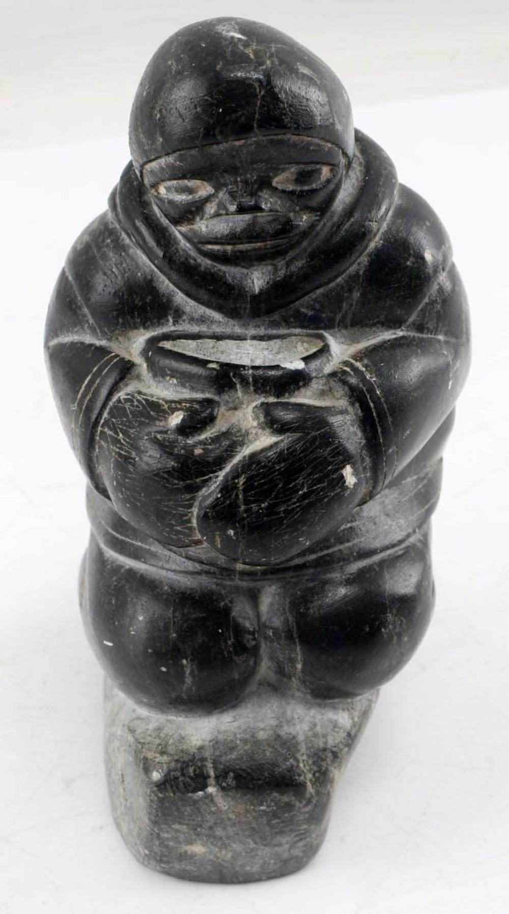 INUIT SOAPSTONE CARVING OF MALE FIGURE