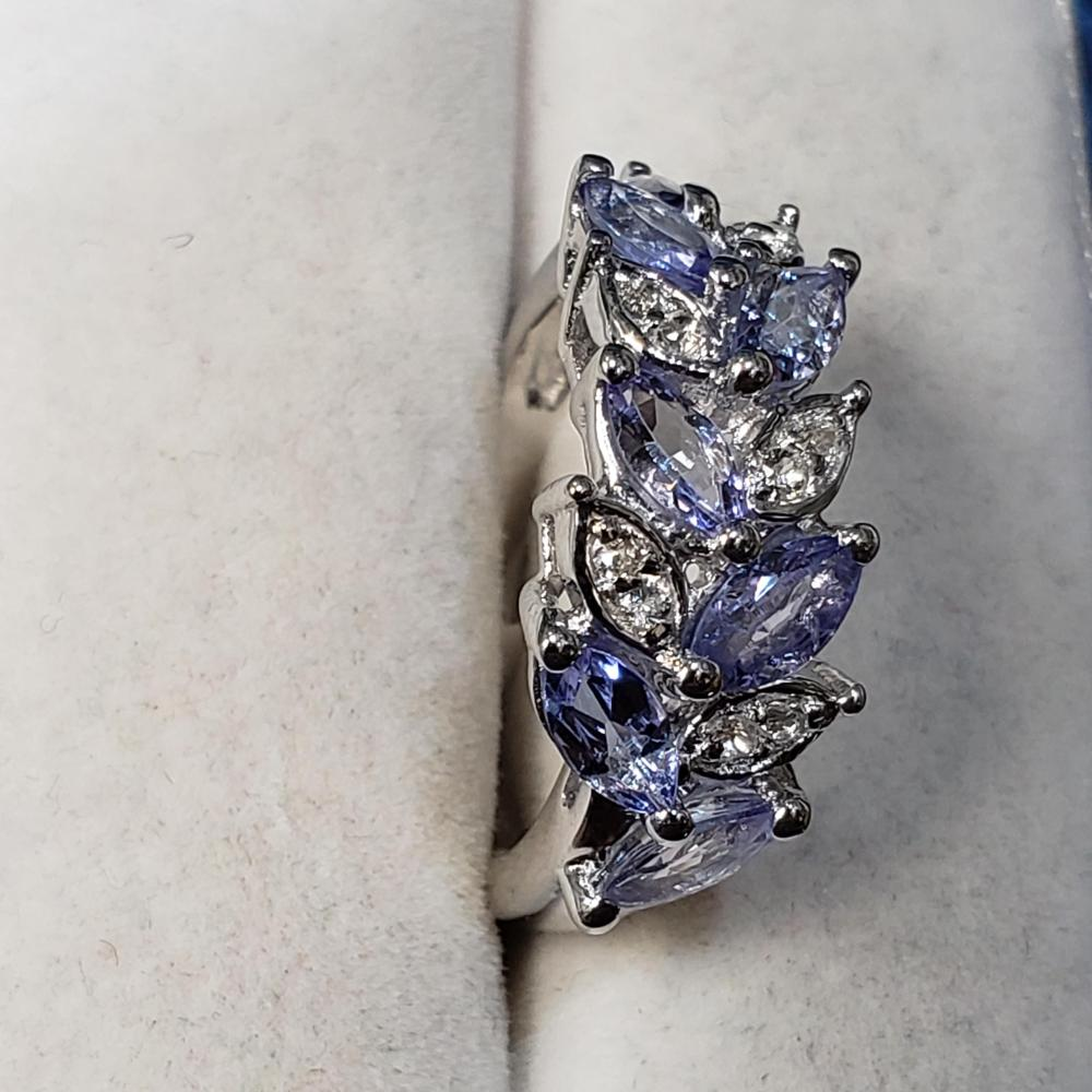Silver Tanzanite(0.9ct) White Topaz Ring