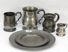 A pair of Georgian pewter plates, each marked London with Touch marks, and a larger pewter plate, 24.5cm diameter, together with four Georgian pewter measures, the largest 12cm high. The Estate of Stanley Crawford Stevens.