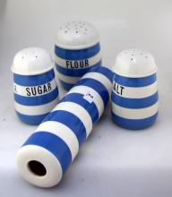 Three Cornish Ware shakers, marked 'sugar', 'flour', and 'salt', together with a rolling pin with ends missing.