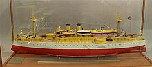 Model Boat of the USS Maine, Painted Red and White Encased in a Glass and Wood Stand, 22