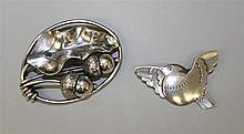 Sterling Silver Pins with Georg Jensen name. Lot of 2
