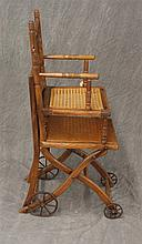 Antique Oak Children's Convertible High Chair / Stroller, Caned Seat, Metal Single Spoke Wheels, 38 1/2