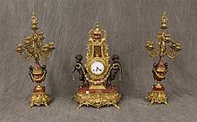 3 Piece Italian Clock Garniture, Brass Case with Marble Plinth and Figures of Pan, Damage to Marble and Candelabra, Clock 25