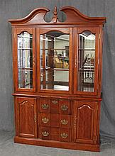 Bookcase, Cherry, Broken Arch Pediment with Finial, Mirrored Back with Lighted and Glass Shelving, Two Glazed Side Doors over Two Do...
