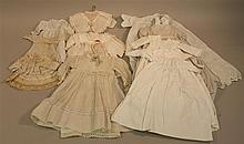 LOT OF (12) ANTIQUE WHITE DOLL DRESSES OF VARIOUS SIZES. Silk - 7