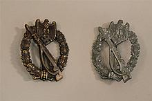 Lot of two German WW II infantry assault badges. Stamped hollow-back