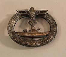German WW II Kriegsmarine U-boat service badge. Badge retains most of its darkened gilt finish typlcal of later wartime production. ...