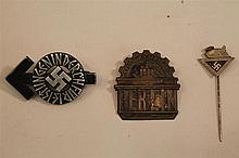 Lot of three German WW II medals and pins. Lot includes a Hitler Youth honor pin in bronze which is numbered and