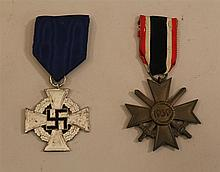 German WW II medal group. Lot contains a Faithful Service medal in silver complete with dark blue morie ribbon and a bronze War Meri...