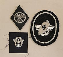 German WW II cloth insignia. Lot includes a machine embroidered silver bullion shoulder insignia attributed to factory guard officer...