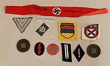 Lot of German WW II cloth insignia. Lot includes various specialty patches, rank insignia, volunteer shields, and unusual NSDAP prin...