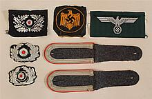 Lot of German WW II cloth insignia. Included are two bullion Army cap cacades, black flat wire Panzer officers cacade, embroidered e...