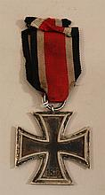 German WW II Iron Cross 2nd class. Iron Cross 2nd class complete with ribbon displaying an untouched patina finish.