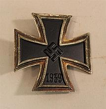 German WW II Iron Cross 1st class. Silver body displays oxidation with all black painted core intact. Reverse displays a thin flat u...
