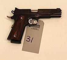 Magnum Research Inc. Desert Eagle 1911G semi-automatic pistol. Cal. 45. 5