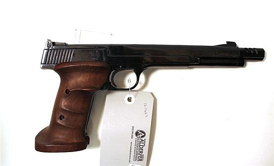"Smith & Wesson Model-41 semi-automatic pistol. Cal. 22 LR. 7"" bbl. SN 13914. Blued finish on metal, muzzle brake, walnut target grip..."