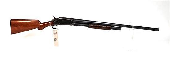 "Marlin Model 1898 pump action shotgun. 12 ga. 28"" bbl. SN 57706. Blued finish on metal, bluing is thin on sharp edges of receiver, r..."