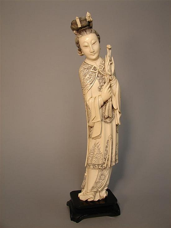 Carved ivory female figure, adorned kimono, hands displaying a scepter, H: 15in