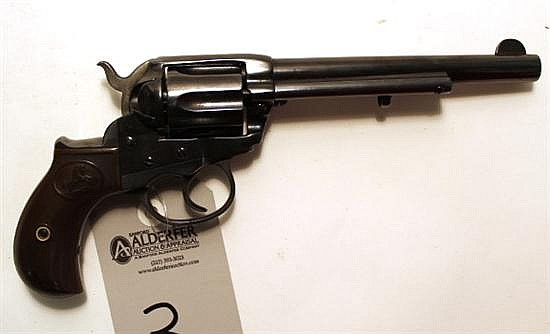 "Colt Model 1877 Lightning double action revolver. Cal. 38. 6"" bbl. SN 157256. Reblued finish on all metal, light pitting can be seen..."