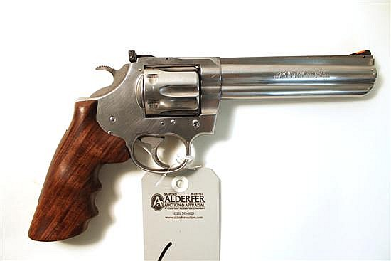 """Colt King Cobra double action revolver. Cal. 357 Mag. 6"""" bbl. SN KV5682. Stainless steel finish on metal, walnut two-piece combat gr..."""