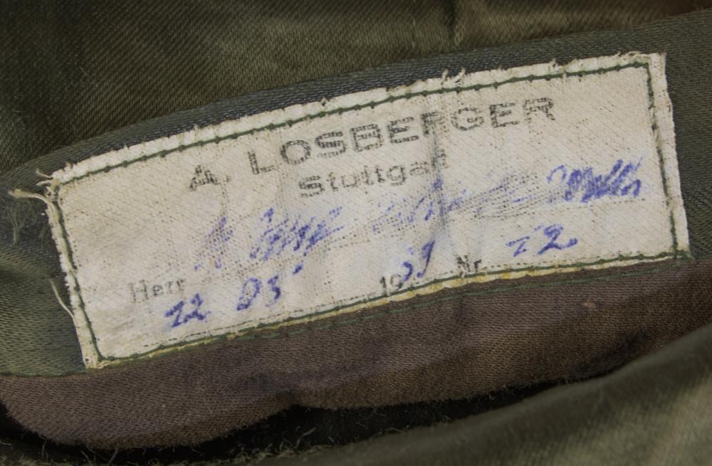 TUNIC OF AN OBERSTURMFUHRER-SS ON HIMMLER'S STAFF