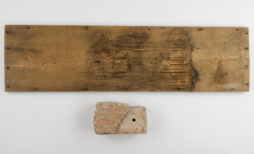 A BRICK AND A WOODEN PANEL FROM MARTIN BORMANN'S HOUSE IN OBERSALZBERG
