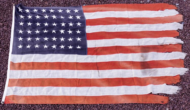 THE LAST AMERICAN FLAG TO LEAVE WAKE ISLAND BEFORE ITS CONQUEST BY JAPAN